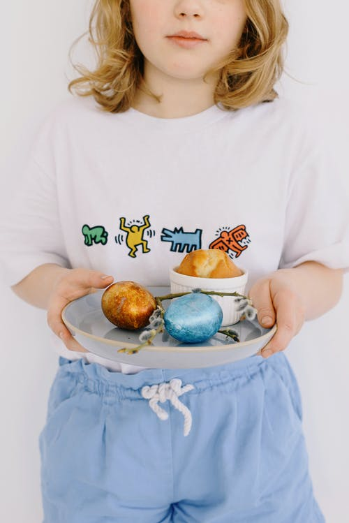 Little Girl Holding a Ceramic Plate