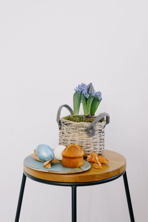 Muffin and Easter Eggs on a Ceramic Plate