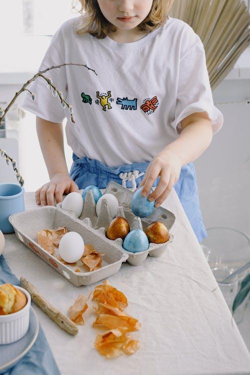 Little Girl Holding a Blue Egg
