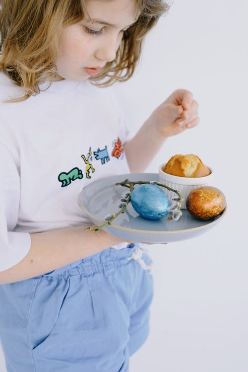 Little Girl Looking at her Plate