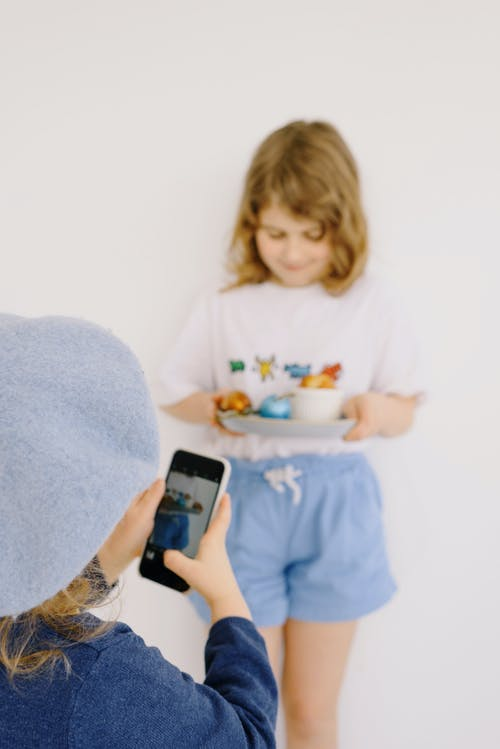 Little Girl Taking a Picture With a Smartphone