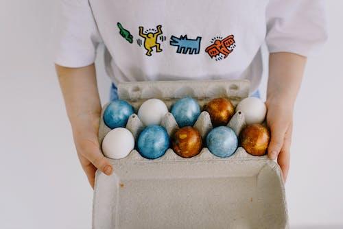 Child Holding an Egg Carton