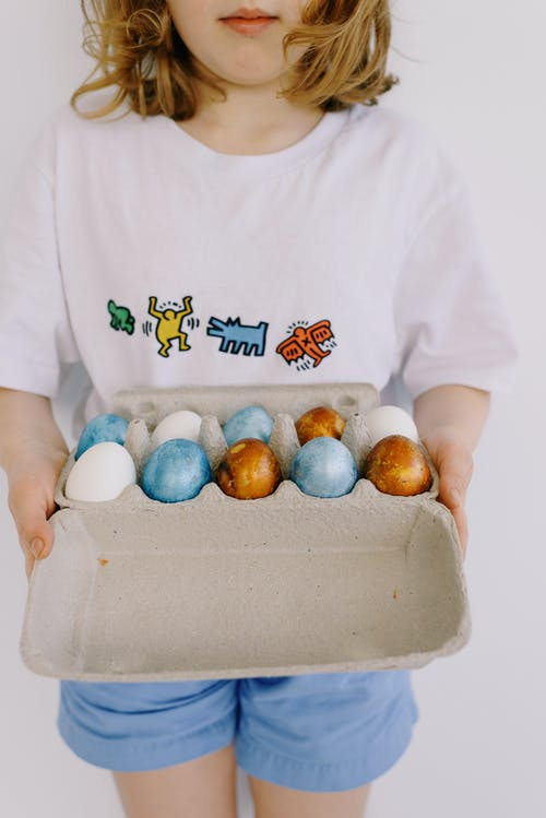Little Girl Holding an Egg Carton