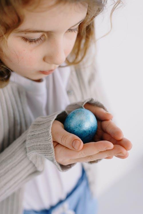 Little Girl Holding an Easter Egg