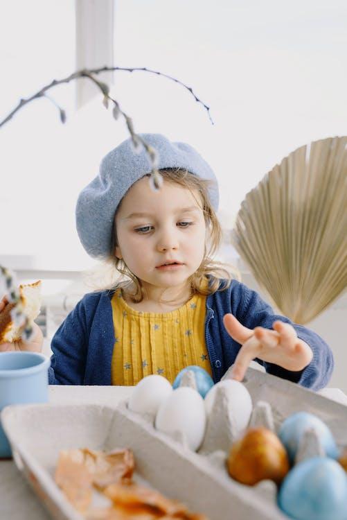 Small Girl Touching an Egg