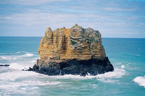 Photo Of Rock Formation on Sea