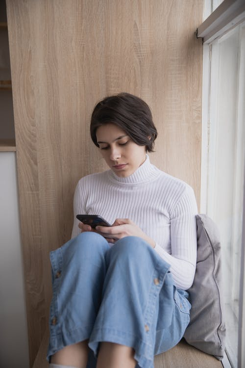 Photo Of Woman Using Her Mobile Phone