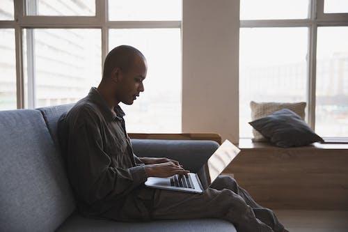 Photo Of Man Using Laptop