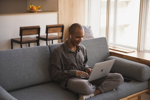 Photo Of Man Using Laptop