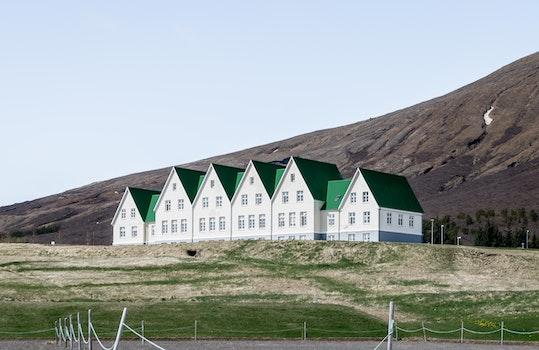 Kostenloses Stock Foto zu island, natur, häuser, hügel