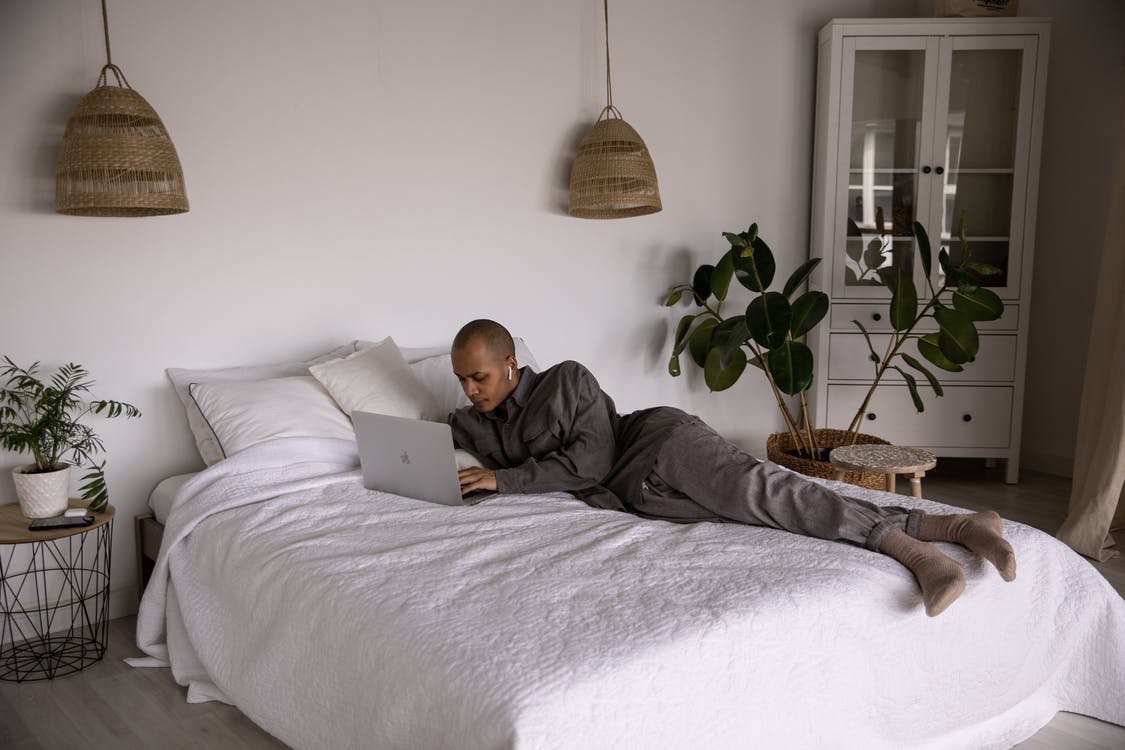 Photo Of Man Laying On Bed