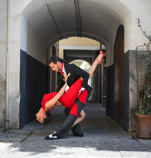 Man and Woman Dancing Tango in a Street