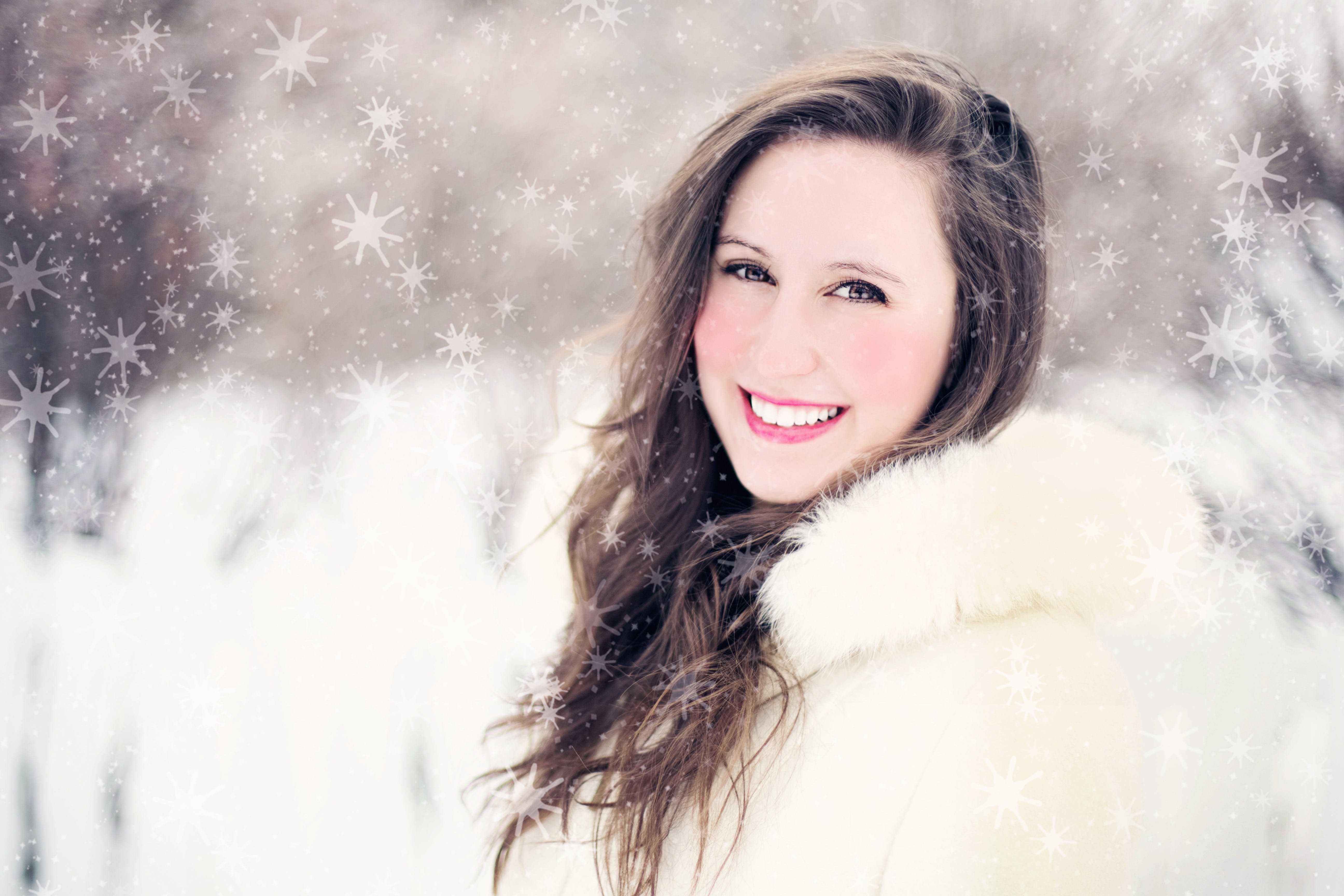 Woman in White Furred Jacket Smiling in Front