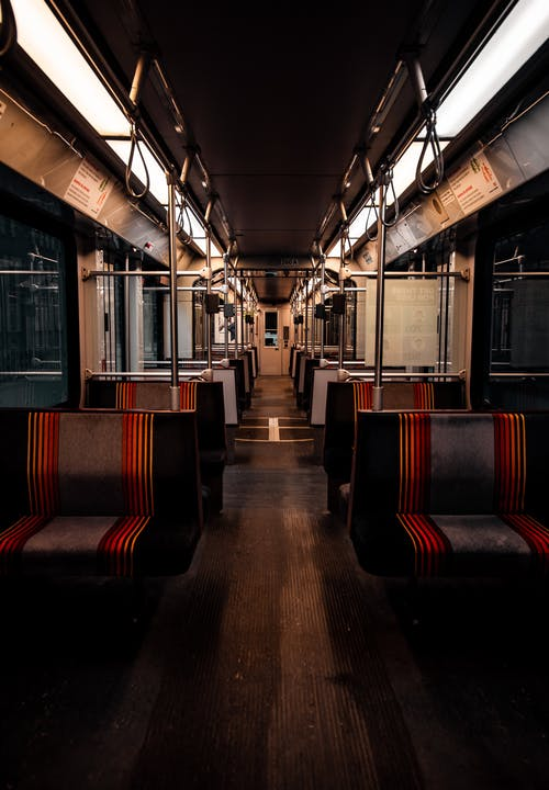 Red and Brown Train Seats