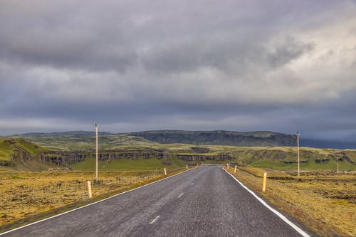 Photo Of Empty Road Under Cloudy Sky