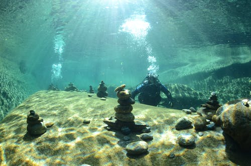 Photo Of Stacked Stones Underwater