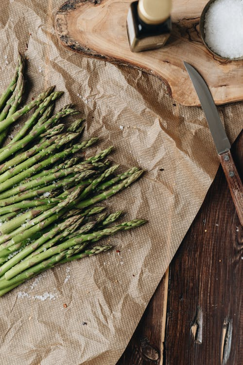 Photo Of Asparagus Near Knife