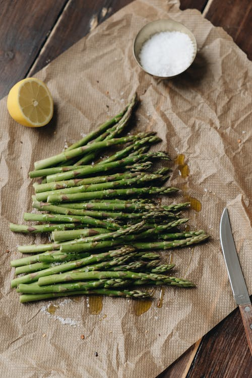 Photo Of Sliced Lemon Near Asparagus