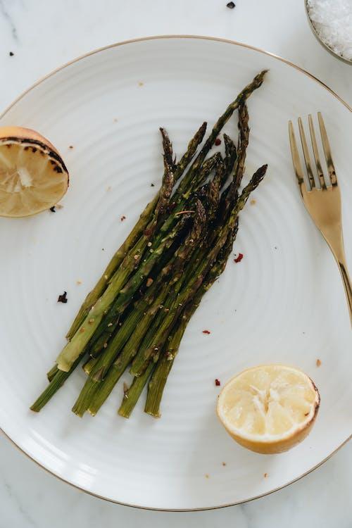 Close-Up Photo Of Asparagus Beside Sliced Lemon