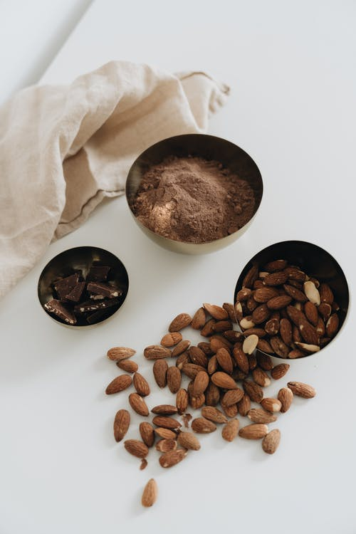 Photo Of Almonds Near Cocoa Powder