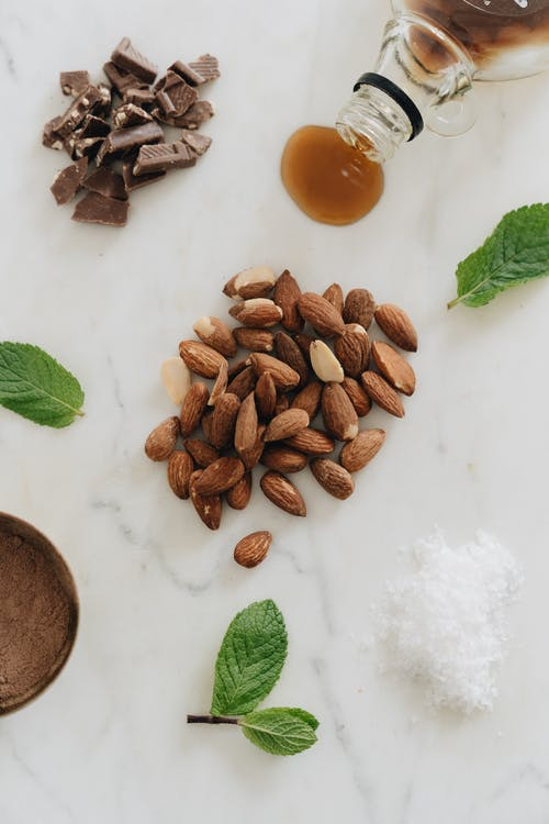 Photo Of Almonds Near Mint Leaves