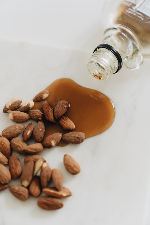 Close-Up Photo Of Almonds With Maple Syrup