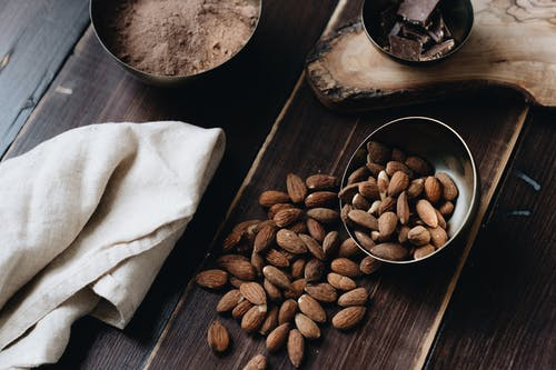 Close-Up Photo Of Almonds Beside Cloth