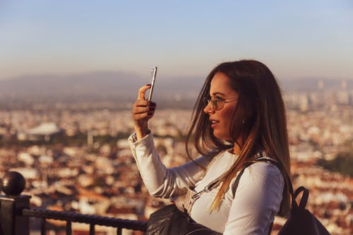 Photo Of Woman Using Mobile Phone