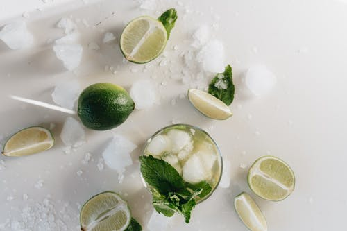 Top View Photo Of Lime Beside Glass