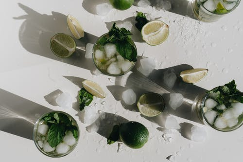 Photo Of Glasses Near Sliced Limes