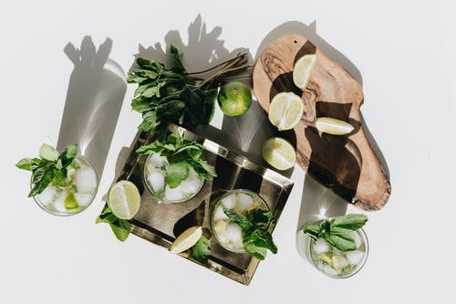 Photo Of Limes On Wooden Surface