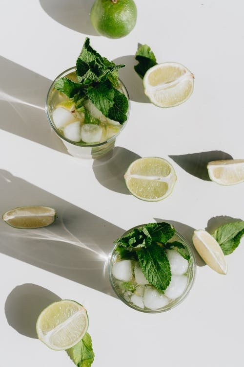 Photo Of Sliced Lime Beside Glass