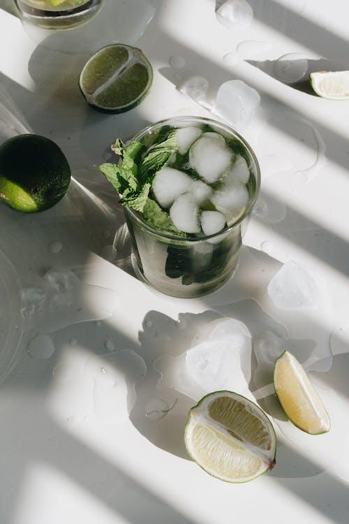 Photo Of Sliced Lime Beside Glasses