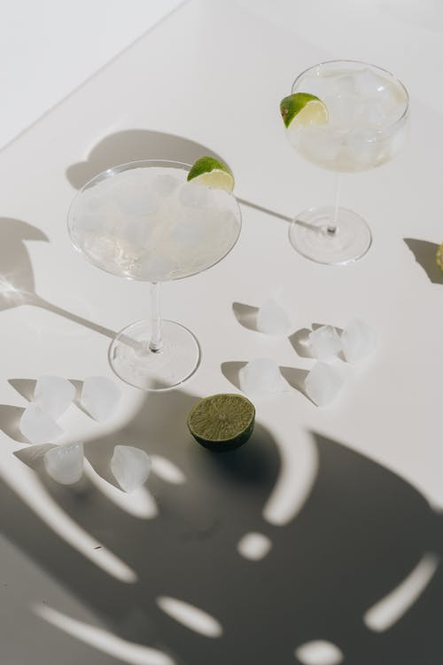 Photo Of Cocktail Glass Beside Sliced Lime