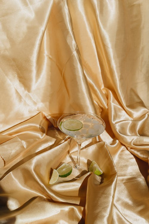 Photo Of Cocktail Glass On Silk Fabric