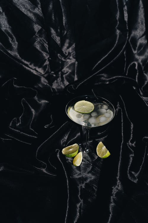 Photo Of Cocktail Glass On Black Silk Fabric