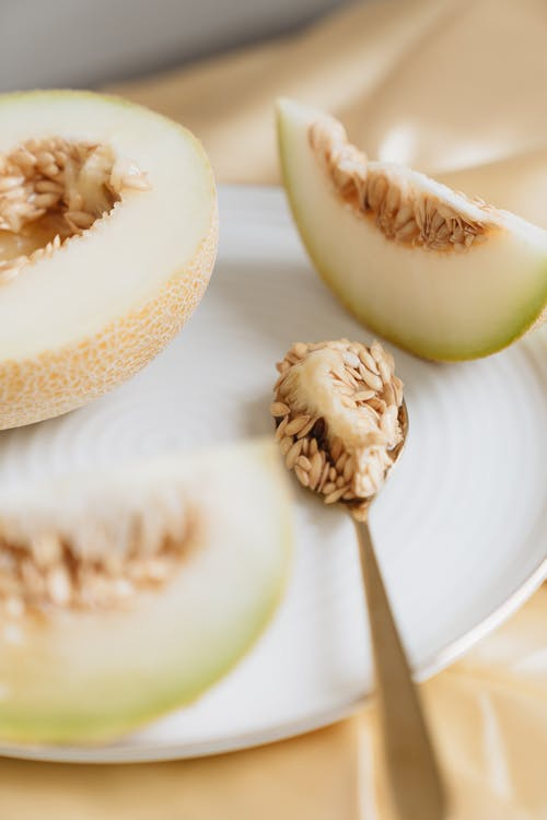 Close-Up Photo Of Spoon With Melon Seeds