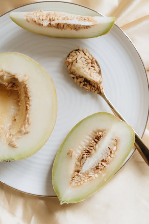 Photo Of Spoon With Melon Seeds