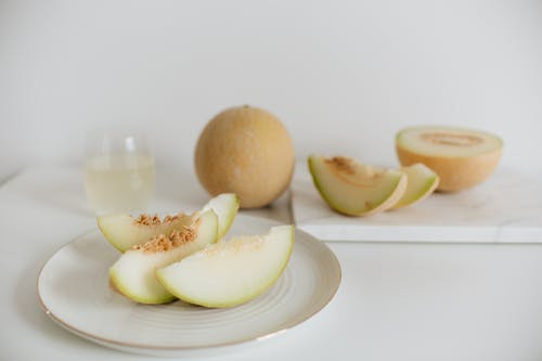 Photo Of Sliced Melon On Plate