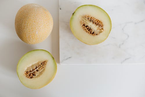 Photo Of Sliced Melon On Marble Surface
