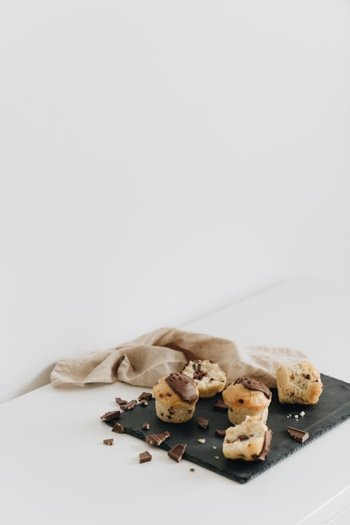 Photo Of Chocolate Muffin Beside Cloth