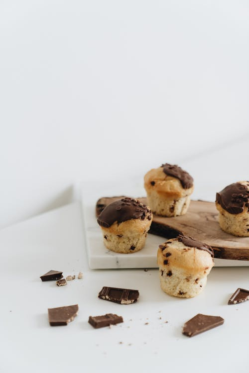 Photo Of Muffins On Wooden And Marble Surface