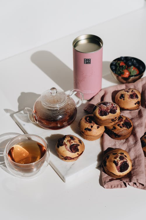 Photo Of Berry Muffins Near Teapot