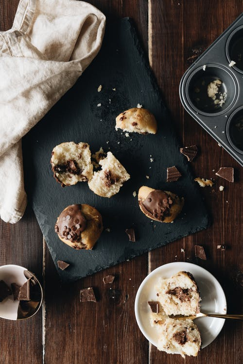 Photo Of Chocolate Muffins On Stone Board