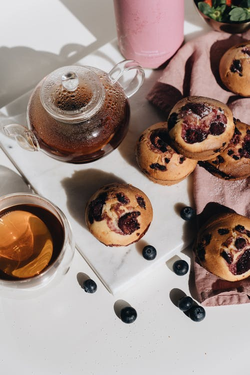 Photo Of Berry Muffins Beside Teapot