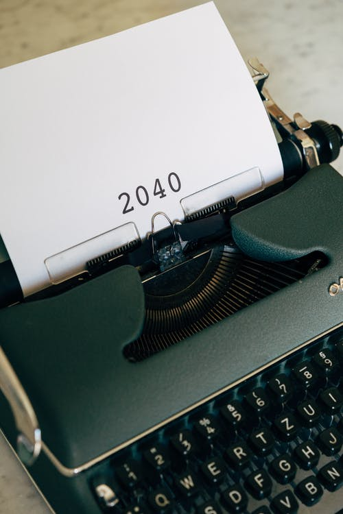 An Old Typewriter With 2040 Typed On Paper