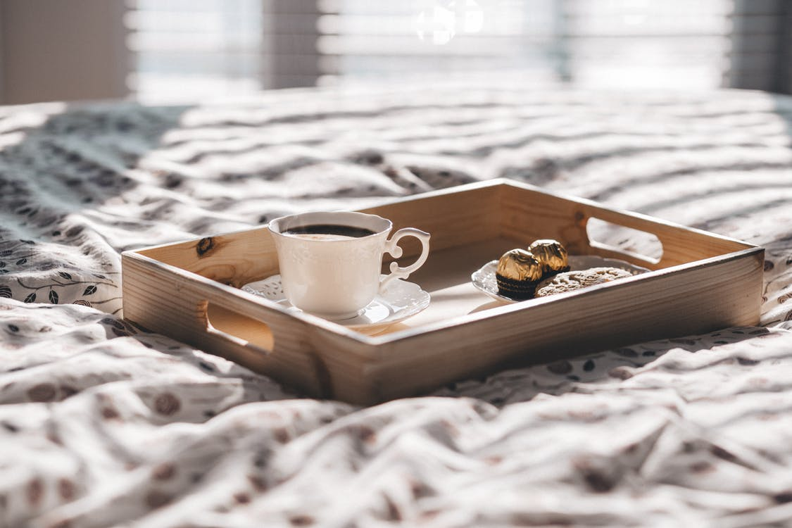 White Teacup on Brown Wooden Tray