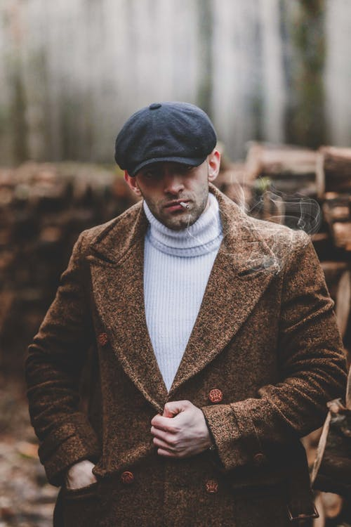 Man in Brown Coat and White Shirt