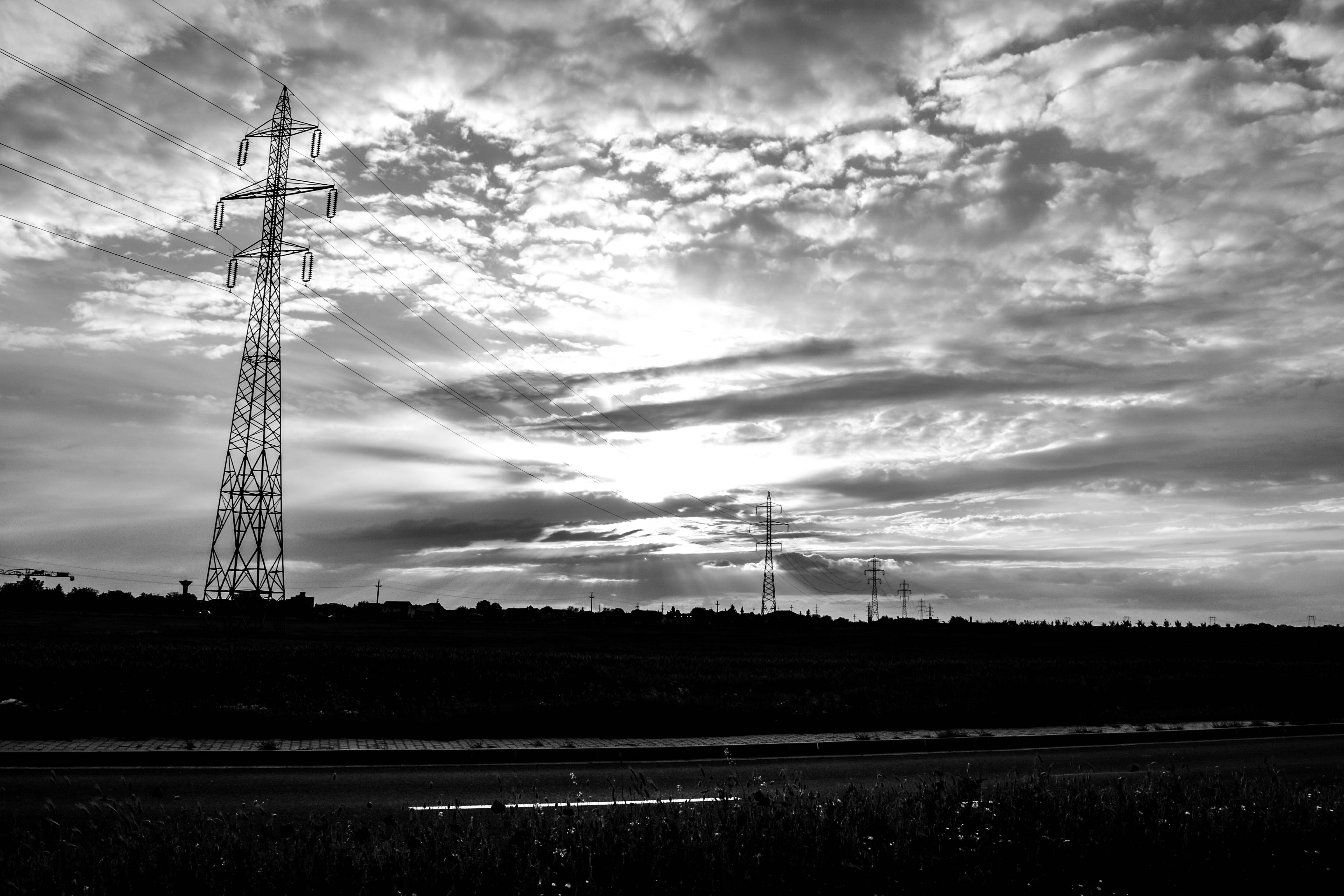 Grayscale Photography Of Transmission Towers Free Stock Photo