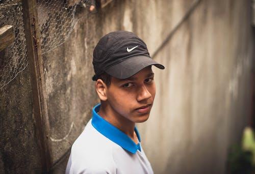 Photo Of Man Wearing Black Hat